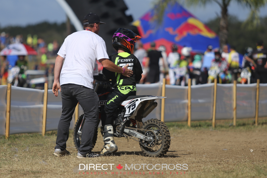 Timmy Ferry gives his son, Evan, a pat on the back after a moto.