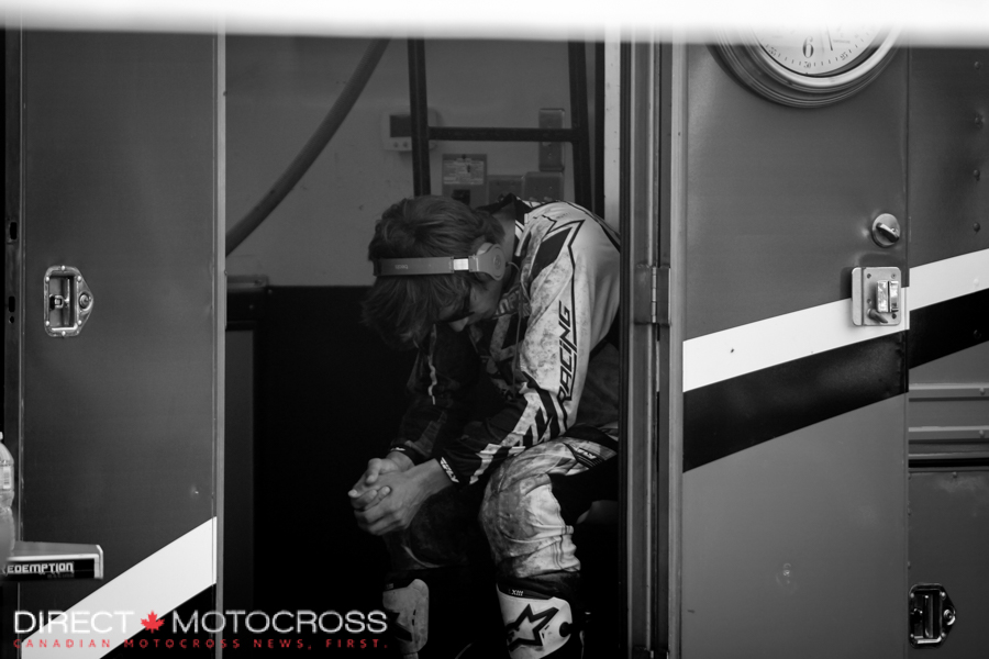 Redemption Racing Fly Dragon KTM's #92 Cade Clason in the zone before a moto. I bet that's country he's listening to.